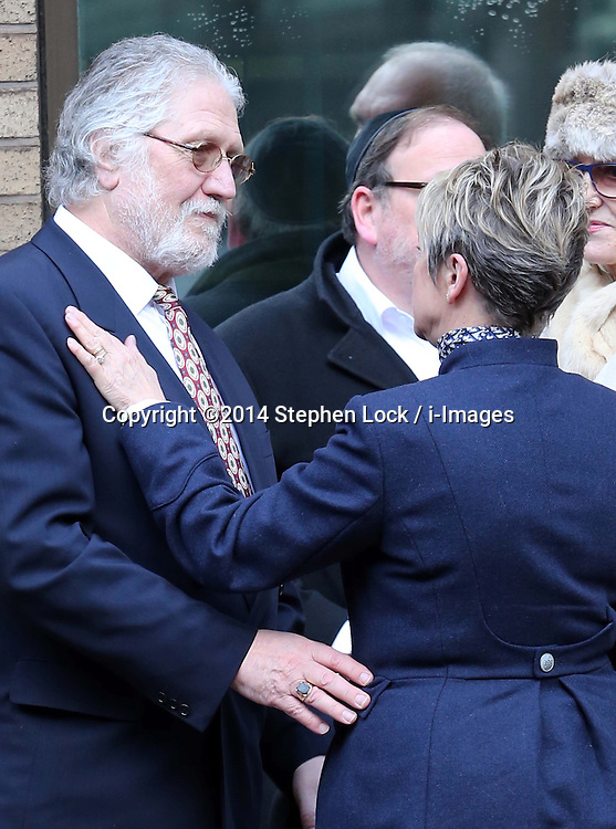 Dave Lee Travis with wife Marianne Griffin outside Southwark Crown Court in London after the jury retired to consider it's verdict , Monday, 10th February 2014. Picture by Stephen Lock / i-Images