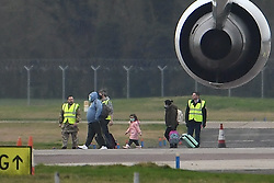 © Licensed to London News Pictures. 31/01/2020. Brize Norton, UK.  Passengers disembark the plane. A plane carrying British Nationals from Wuhan in China to the UK is seen landing at RAF Brize Norton in Oxfordshire. The flight, carrying 83 Britons and 27 foreign nationals from the centre of the coronavirus outbreak, was initially delayed because of a lack of clearance by Chinese Authorities. Photo credit: Ben Cawthra/LNP