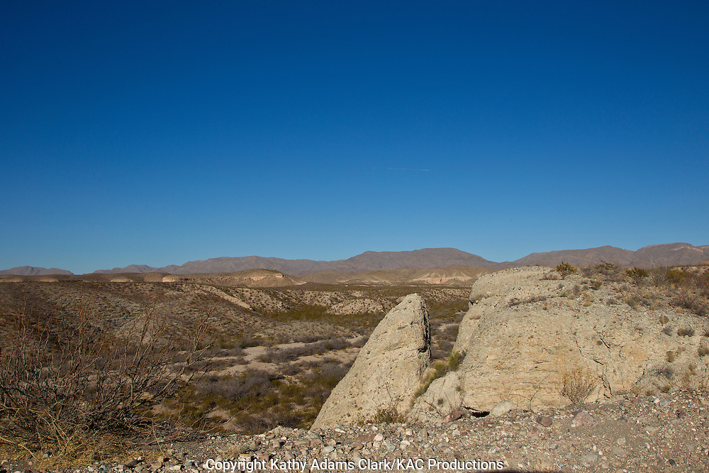 The Chihuahuan Desert, outside El Paso, Texas.  Roadcuts showing the soft rocky hills with alluvial fan deposits eroded from surrounding mountains.