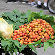 A fruit stall on the back of a bicycle in Hanoi's Old Quarter