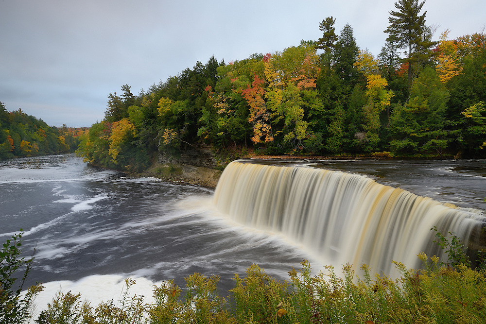Fall colors begin to appear at Tahquamenon's Upper Falls, September 2014.<br />
