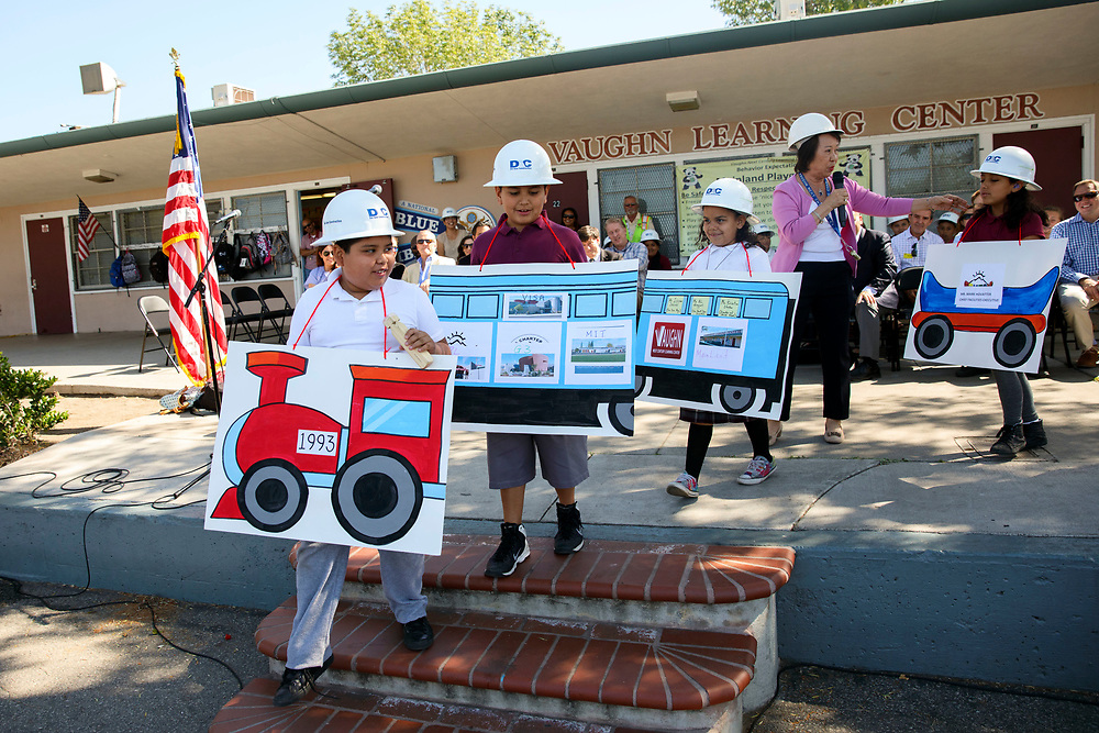 Yvonne Chan, founding Principal, tells a story about the school's history to students during a ribbon cutting celebration at Vaughn Next Century Learning Center on Friday, April 21, 2017 in San Fernando, Calif. A new project will provide upgraded classrooms on an L.A. Unified campus that hosts a charter school, replacing 21 old portable classrooms with new construction classrooms made with recycled shipping containers. © 2017 Patrick T. Fallon