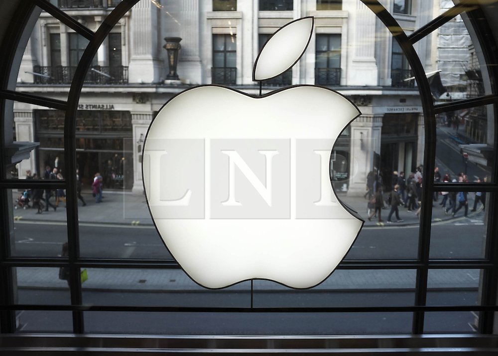 © Licensed to London News Pictures. 27/10/2013. London, UK.  An Apple logo display at Apple's UK flagship Regent Street store.  Apple is to announce its Q4 Fiscal Results tomorrow.  Photo credit : Richard Isaac/LNP