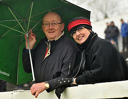 Undercover of the elements at the sportspark Westport were Paul and Carmel Fitzgerald watching Westport United take on Freebooters FC in the FAI junior cup.<br /> Pic Conor McKeown