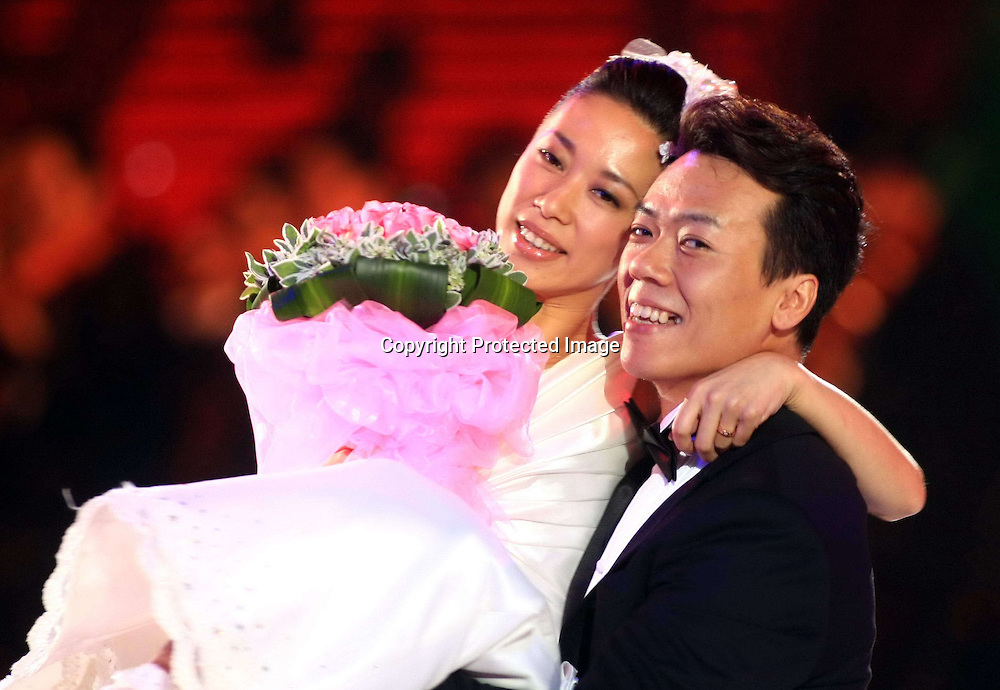 Sep 04, 2010; Beijing, CHINA; Olympic champions Shen Xue and Zhao Hongbo of China wed Saturday in a perfect setting on the ice, surrounded by fellow Olympians including Evgeni Plushenko, Johnny Weir, Alexei Yagudin, Stephane Lambiel, Joannie Rochette and Mao Asada.