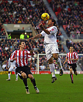 Photo: Andrew Unwin.<br /> Sunderland v Luton Town. Coca Cola Championship. 09/12/2006.<br /> Luton's Lewis Emanuel (R) heads the ball away from Sunderland's Stephen Elliott (L).