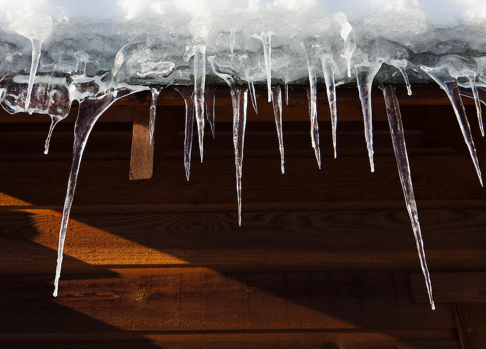 Icicles hanging from the eves of a house.