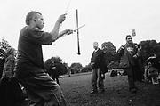 Man playing with sticks, 12v Teknival, Bristol, 09.07.11