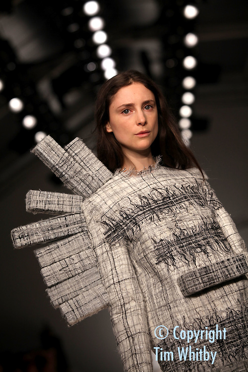 LONDON, ENGLAND - FEBRUARY 17:  A model walks the runway during the Central Saint Martins MA Fashion show featuring student designer Hellen Van Rees at London Fashion Week Autumn/Winter 2012 at Somerset House on February 17, 2012 in London, England  (Photo by Tim Whitby/Getty Images)