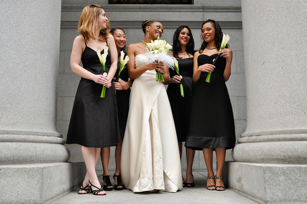 Uzoezi and her bridesmaids between columns of the Pacific Coast Stock Exchange building, San Francisco