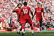 The Red Arrows - Liverpool front three Liverpool forward Mohamed Salah (11) Liverpool forward Sadio Mane (10) and Liverpool forward Roberto Firmino (9) celebrate Liverpool forward Sadio Mane (10) second goal 2-1 during the Premier League match between Liverpool and Newcastle United at Anfield, Liverpool, England on 14 September 2019.