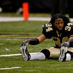 2009 November 30: New Orleans Saints cornerback Mike McKenzie (34) stretches prior to kickoff of a 38-17 win by the New Orleans Saints over the New England Patriots at the Louisiana Superdome in New Orleans, Louisiana.