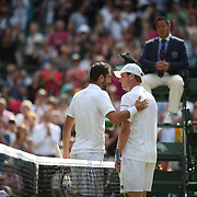 LONDON, ENGLAND - JULY 14: Winner Marin Cilic of Croatia with Sam Querrey of the United States after the Gentlemen's Singles Semi-final of the Wimbledon Lawn Tennis Championships at the All England Lawn Tennis and Croquet Club at Wimbledon on July 14, 2017 in London, England. (Photo by Tim Clayton/Corbis via Getty Images)