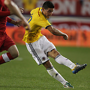 James Rodríguez, Colombia, shoots to score the winning goal during the Columbia Vs Canada friendly international football match at Red Bull Arena, Harrison, New Jersey. USA. 14th October 2014. Photo Tim Clayton