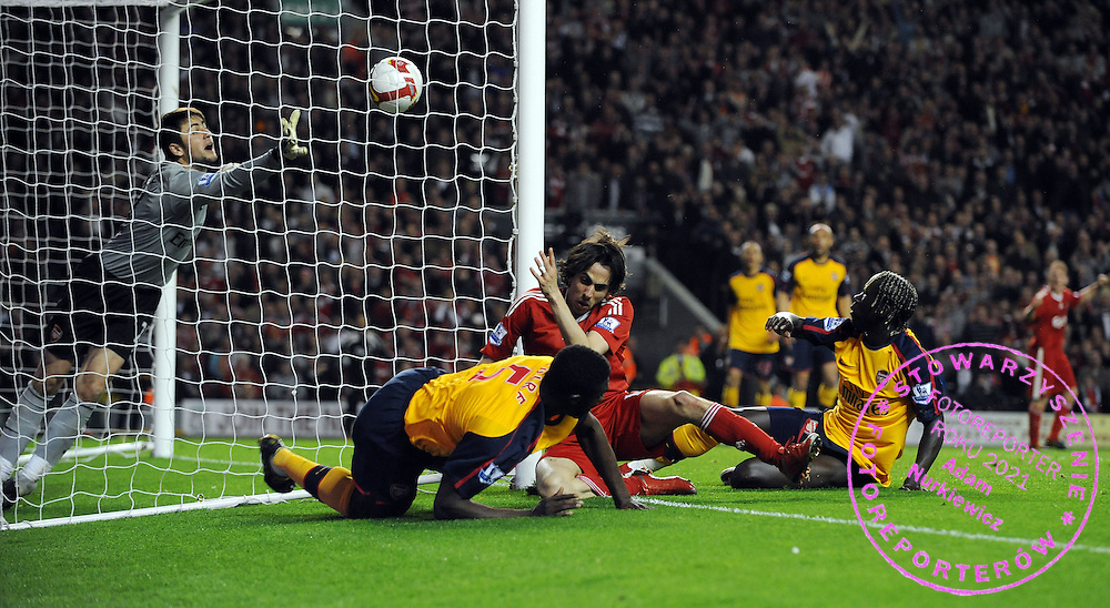 Yossi Benayoun Scores 2nd goal as he's challenged by Arsenal's Bacary Sagna.Liverpool 2008/09.Liverpool V Arsenal (4-4) 21/04/09.The Premier League.Photo Robin Parker Fotosports International