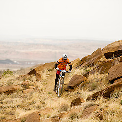 A member of team 2 BLISS Co-ed Duo team rides third mesa just as the weather starts to turn sour.