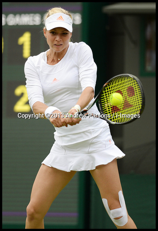 Maria Kirilenko playing against Britain's Laura Robson on court No1 at the Wimbledon Tennis Championships. Robson went onto win the game.<br /> Tuesday, 25th June 2013<br /> Picture by Andrew Parsons / i-Images