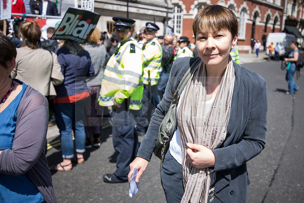 © Licensed to London News Pictures . 06/07/2016 . London , UK . CAROLINE LUCAS of the Green Party at Stop the War protest outside the venue as the report is delivered . Scene outside the Queen Elizabeth II Conference Centre in Westminster , ahead of the publication of the Chilcot Inquiry's report in to the 2003 invasion of Iraq . Photo credit : Joel Goodman/LNP