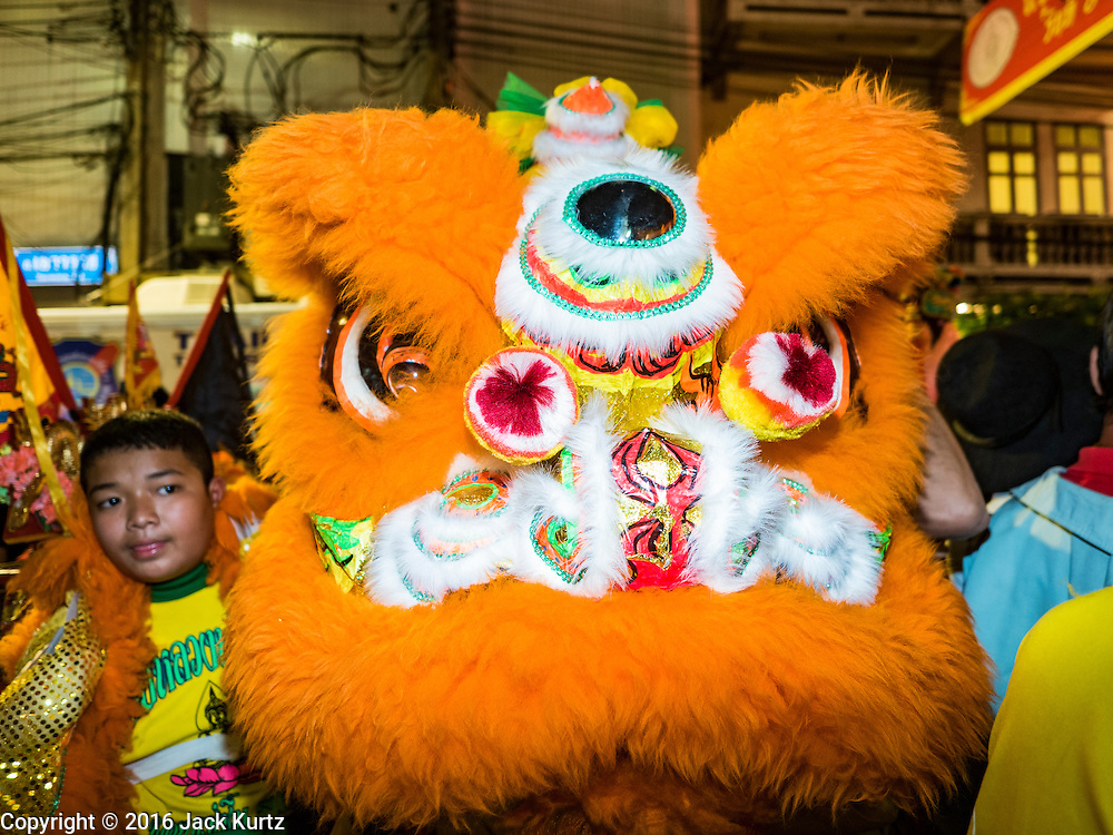 "07 FEBRUARY 2016 - BANGKOK, THAILAND: Traditional Chinese New Year lion dancers perform on Yaowarat Road in the heart of Bangkok's Chinatown.  Chinese New Year, also called Lunar New Year or Tet (in Vietnamese communities) starts Monday February 8. The coming year will be the ""Year of the Monkey."" Thailand has the largest overseas Chinese population in the world; about 14 percent of Thais are of Chinese ancestry and some Chinese holidays, especially Chinese New Year, are widely celebrated in Thailand.        PHOTO BY JACK KURTZ"