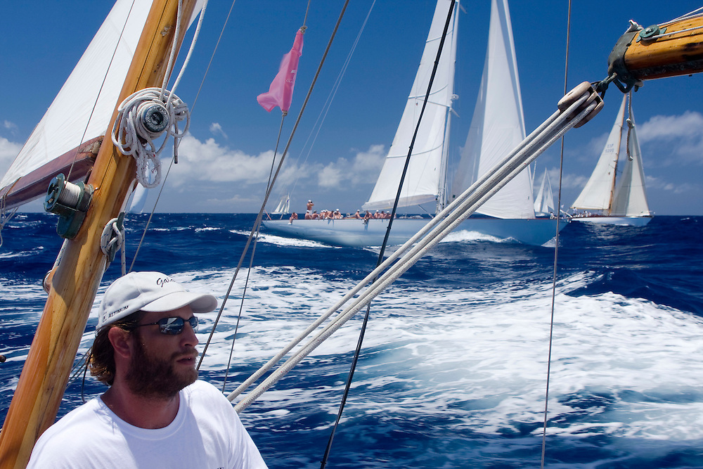 The skipper concentrates during the 2008 Antigua Classic Yacht Regatta . This race is one of the worlds most prestigious traditional yacht races. It takes place annually off the cost of Antigua in the British West Indies. Antigua is a yachting haven, historically a british navy base in the times of Nelson.