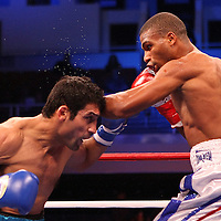 Luis Carlos Abregu (L) and Thomas Dulorme fight for the WBC International title during the HBO Triple Explosion fight at the Turning Stone Resort Casino in Verona, NY, on Saturday, Oct 27, 2012.  Abregu won the bout by TKO in the 7th round.(AP Photo/Alex Menendez)