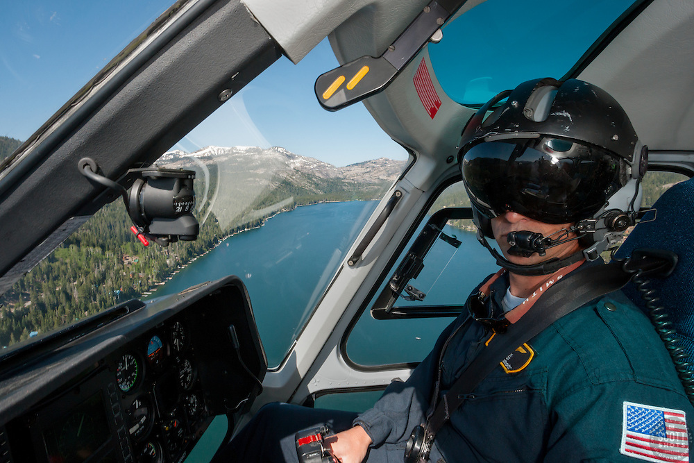 """""""Care Flight Pilot Over Donner Lake"""" - This Care Flight Pilot was photographed flying in a helicopter over Donner Lake in Truckee, California."""