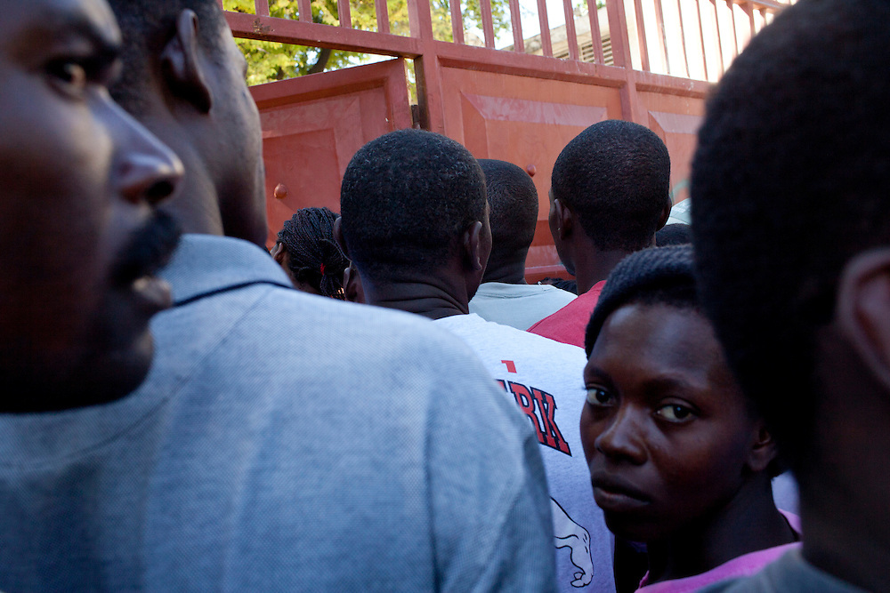 People wait to obtain voter registration cards on Tuesday, November 23, 2010 in Port-au-Prince, Haiti.