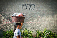 El Salvador, May 2014. A wall with the names of the villagers killed during the civil war, commemmorates some of the heaviest battle zones in El Salvador. Set in the tropics and consisting of cloud forests, volcanic lakes and national parks, El Salvador boasts quiet Spanish colonial towns and a glorious coastline with world-class waves. Photo by Frits Meyst / MeystPhoto.com