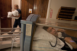 Chris Cox, 29, is seen receiving hyperbaric oxygen therapy, Destin, Fla., Nov. 18, 2011. Cox was left with debilitating back pain after an A.T.V. accident. He underwent physical therapy to no avail and accidentally overdosed on Oxycontin, leaving him clinically deceased for 15 to 30 minutes. He was revived but suffered severe lack of oxygen to his brain and was diagnosed as minimally conscious. Cox's family entered him into a clinical trial, testing medicines that evoked Òparadoxical excitation,Ó such as Ambien, and have witnessed a heightened sense of awareness in their son.