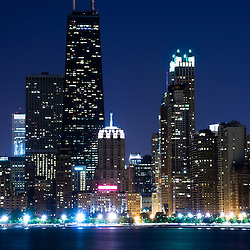 Photo of Chicago skyline at night with the John Hancock Center building and other popular downtown Chicago city buildings. The John Hancock Center is one of the world's tallest skyscrapers and is a famous fixture in the Chicago skyline.