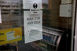 A shot of a sign saying 'Max 2 of Any Item' outside a Co-Operative store<br /> <br /> <br /> Ben Booth | 20/03/2020