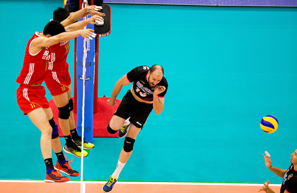 Hugo Gaspar (16) of Portugal is blocked by Xin Geng (11) and Daoshuai Ji (10) of China during a World League Volleyball match at the Sasktel Centre in Saskatoon, Saskatchewan Canada on June 24, 2016.