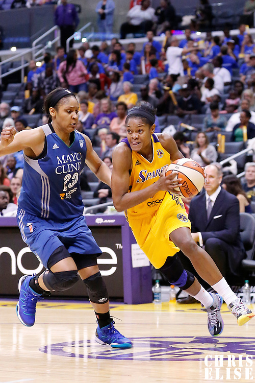 17 June 2014: Los Angeles Sparks guard/forward Alana Beard (0) drives past Minnesota Lynx forward Maya Moore (23) during the Minnesota Lynx  94-77 victory over the Los Angeles Sparks, at the Staples Center, Los Angeles, California, USA.