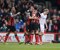 Bournemouth's Yann Kermorgant celebrates with his team mates after scoring his penalty to make it 1-0. - Photo mandatory by-line: Alex James/JMP - Mobile: 07966 386802 - 21/03/2015 - SPORT - Football - Bouremouth - Goldsands Stadium - Bournemouth v Middlesbrough - Sky Bet Championship