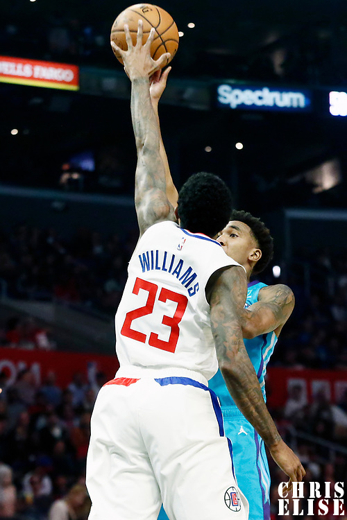 LOS ANGELES, CA - OCT 28: Lou Williams (23) of the LA Clippers blocks a shot by Malik Monk (1) of the Charlotte Hornets during a game on October 28, 2019 at the Staples Center, in Los Angeles, California.
