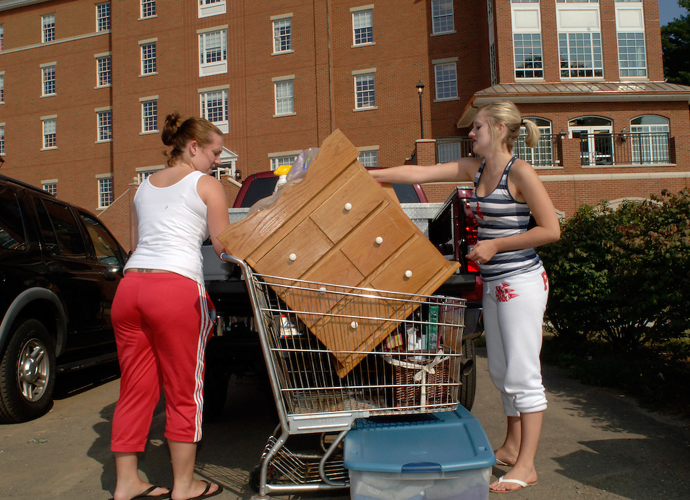 Emily Scott (left) helps her friend, Ohio University sophomore Molly Tope, move into Adams Hall Sunday afternoon.