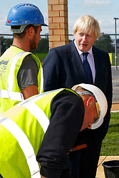 © Licensed to London News Pictures. 26/05/2015. London, UK. The Mayor of London, Boris Johnson visiting the new Mandeville Place Orchard in Queen Elizabeth Olympic Park on Tuesday 26 May 2015 to mark London Tree Week. Photo credit : Tolga Akmen/LNP