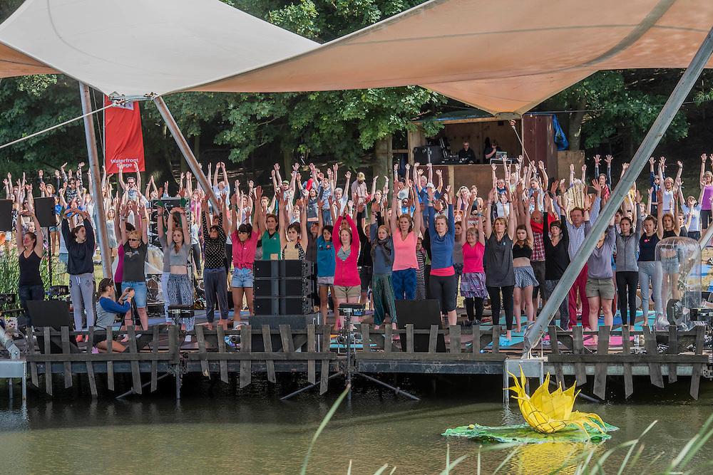 Yoga class on the waterfront stage - The 2016 Latitude Festival, Henham Park, Suffolk.