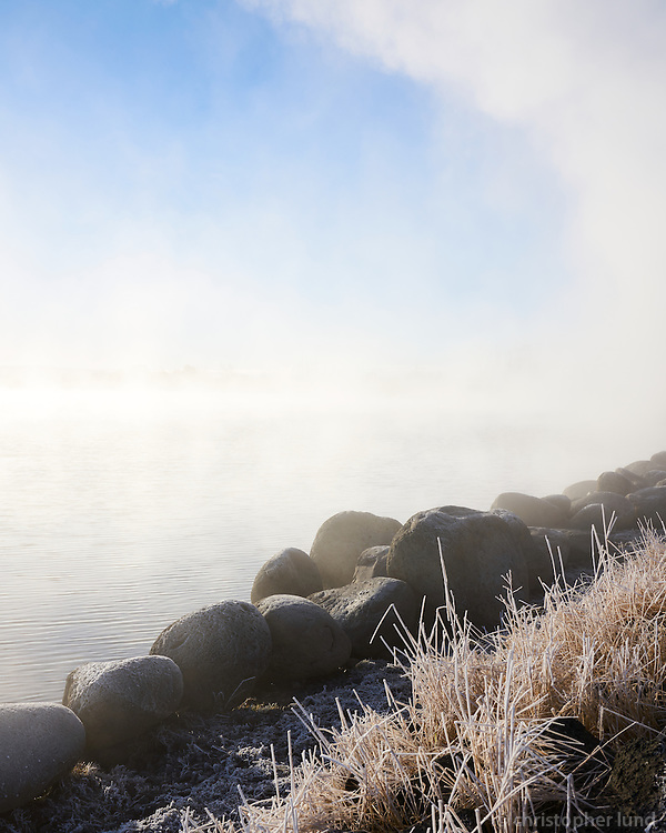 Steam from geothermal springs at Lake Laugarvatn in winter, South Iceland.
