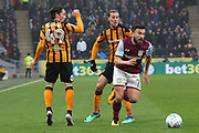 Aston Villa midfielder Robert Snodgrass (7) beats two Hull City defenders during the EFL Sky Bet Championship match between Hull City and Aston Villa at the KCOM Stadium, Kingston upon Hull, England on 31 March 2018. Picture by Mick Atkins.