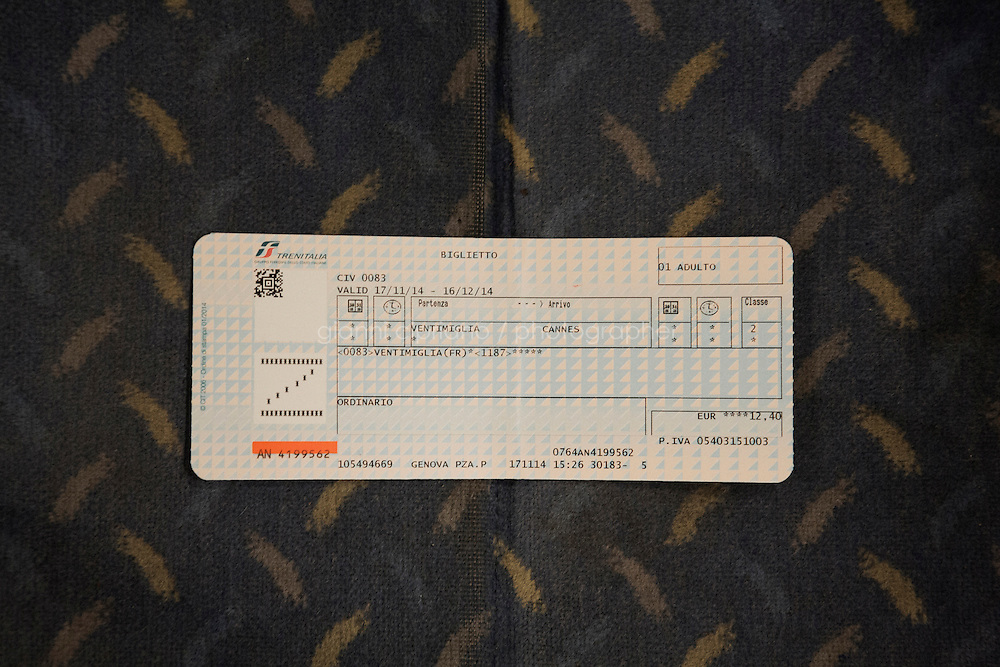 BEAUSOLEIL, FRANCE - 17 NOVEMBER 2014: The train ticket used by Afghan refugees from Ventimiglia to Cannes to cross the border between Italy and France, Beausoleil, France, on November 17th 2014. <br /> <br /> The Ventimiglia-Menton border is the border between Italy and France crossed by migrants who decide to continue their journey up north towards countries such as Germany, Sweden, The Netherlands and the UK where the process to receive the refugee status or humanitarian protection is smoother and faster. in Ventimiglia, Italy, on November 17th 2014.