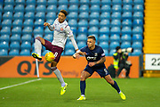Sean Clare (#8) of Heart of Midlothian FC gets to the ball ahead of Eamonn Brophy (#9) of Kilmarnock FC during the Ladbrokes Scottish Premiership match between Kilmarnock FC and Heart of Midlothian FC at Rugby Park, Kilmarnock, Scotland on 23 November 2019.