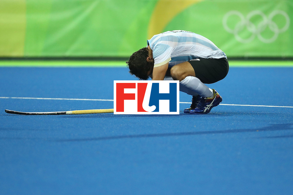 RIO DE JANEIRO, BRAZIL - AUGUST 18:  Juan Lopez #17 of Argentina lays on the ground during the Men's Hockey Gold Medal match between Belgium and Argentina on Day 13 of the Rio 2016 Olympic Games at Olympic Hockey Centre on August 18, 2016 in Rio de Janeiro, Brazil.  (Photo by Sean M. Haffey/Getty Images)