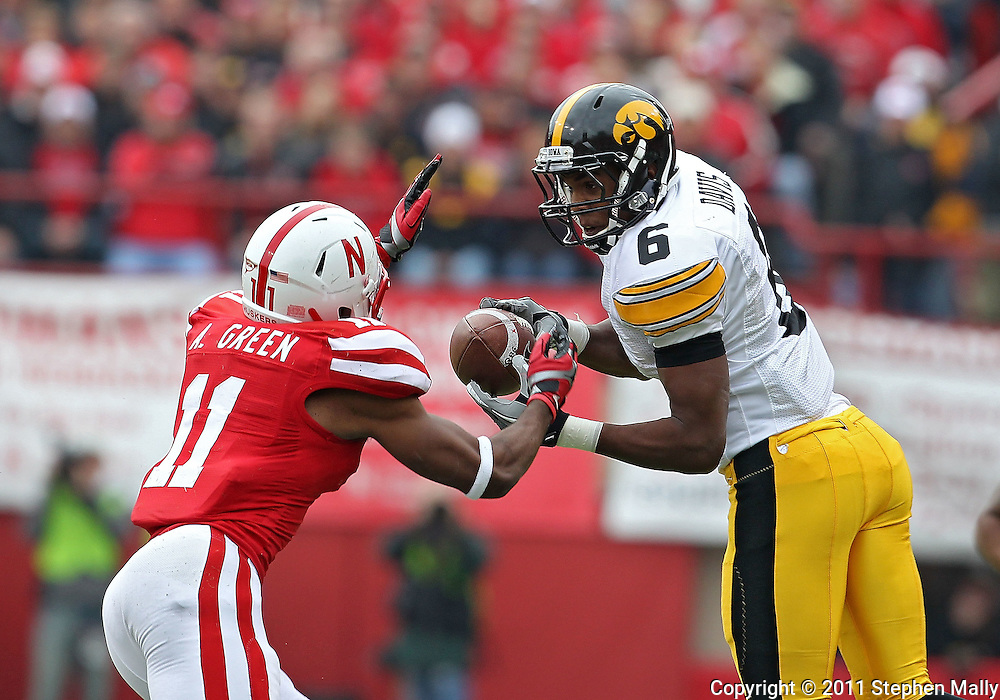 November 25, 2011: Iowa Hawkeyes wide receiver Keenan Davis (6) pulls in a pass in front of Nebraska Cornhuskers cornerback Andrew Green (11) during the first half of the NCAA football game between the Iowa Hawkeyes and the Nebraska Cornhuskers at Memorial Stadium in Lincoln, Nebraska on Friday, November 25, 2011.