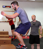 (from left) Aaron Pertner of Dayton, Chad Banter of Centerville, Kristen Pertner of Dayton and owner Jason Hoskins of Dayton during a workout of the day session at Vigor Crossfit in Moraine, Wednesday, January 25, 2012.