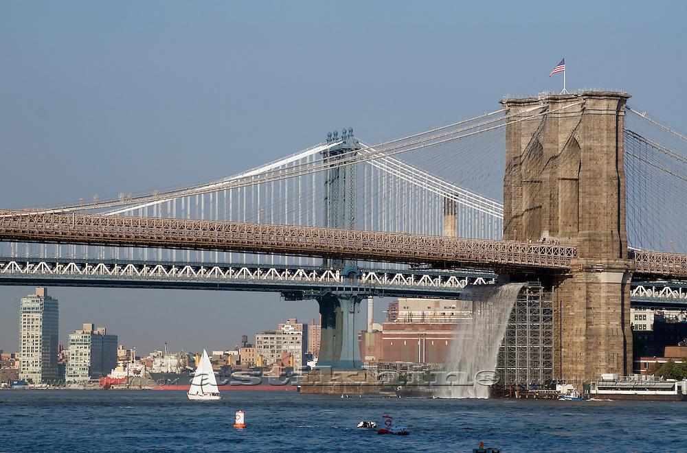 Small Sailboat under the Bridge