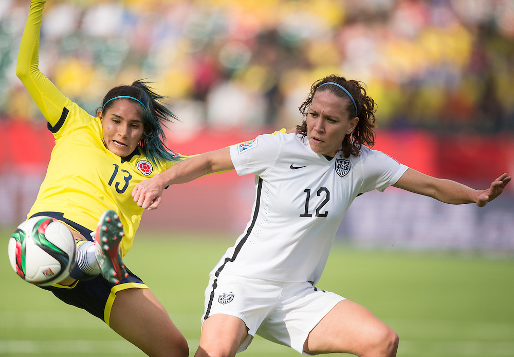 Columbia's Angela Clavijo (L) and the United States' Lauren Holiday vie for the ball during their FIFA Women's World Cup Group of 16 Match against Colombia at Commonwealth Stadium in Edmonton, Canada on June 22, 2015. The U.S. defeated Colombia 2-0 to advance to the quarter finals.   AFP PHOTO/GEOFF ROBINS