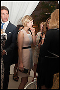 PRINCE PAVLOS OF GREECE;  ROSAMUND PIKE;  , Cartier dinner in celebration of the Chelsea Flower Show. The Palm Court at the Hurlingham Club, London. 19 May 2014.