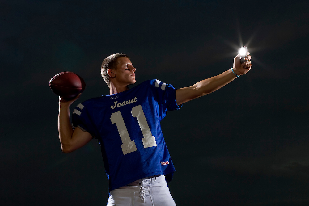 "WILLIE J. ALLEN JR., | Times.Jesuit high school's quarterback Bobby Eveld rears back to throw the ball down field as he checks his cell phone for tweets. The top Hillsborough County High School football players Social Networking and portraits.  The theme a ""Tweet World.""WILLIE J. ALLEN JR., 