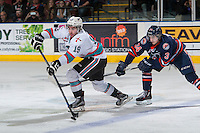 KELOWNA, CANADA - APRIL 4: Dillon Dube #19 of Kelowna Rockets passes the puck while being back checked by Deven Sideroff #34 of Kamloops Blazers on April 4, 2016 at Prospera Place in Kelowna, British Columbia, Canada.  (Photo by Marissa Baecker/Shoot the Breeze)  *** Local Caption *** Dillon Dube; Deven Sideroff;